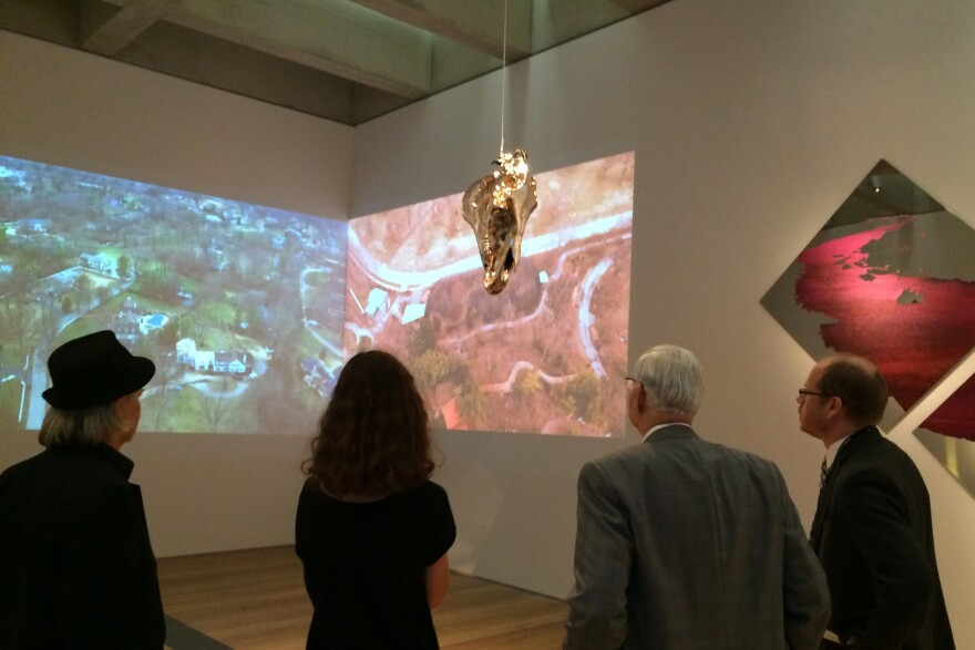 "Musem-goers view  Andrea Stanislav's ""Convergence Infinité"" at the St. Louis Art Museum"