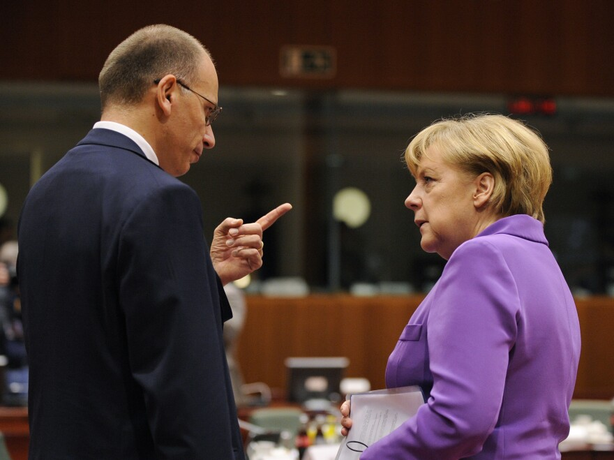 German Chancellor Angela Merkel (right) talks with Italian Prime Minister Enrico Letta on the second day of an European Council meeting in Brussels on Friday.