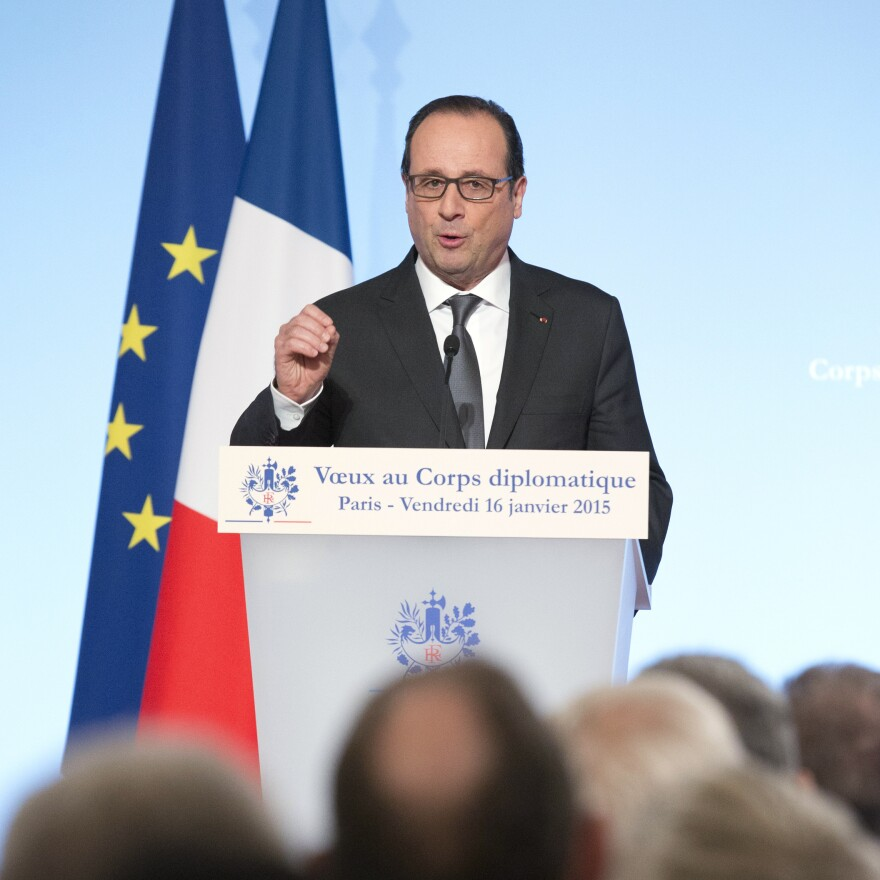 French President Francois Hollande gestures as he delivers a speech to foreign ambassadors during a ceremony to extend New Year wishes at the Elysee Palace in Paris on Friday.