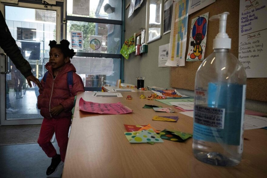 A child whose parents are essential employees attends the Borderouge elementary school used as an emergency day care center in southern France.