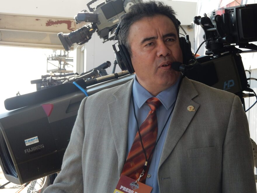 Dr. Ruben Pizarro in the broadcast booth for the 2017 Texas-Oklahoma game at the Cotton Bowl in Dallas.