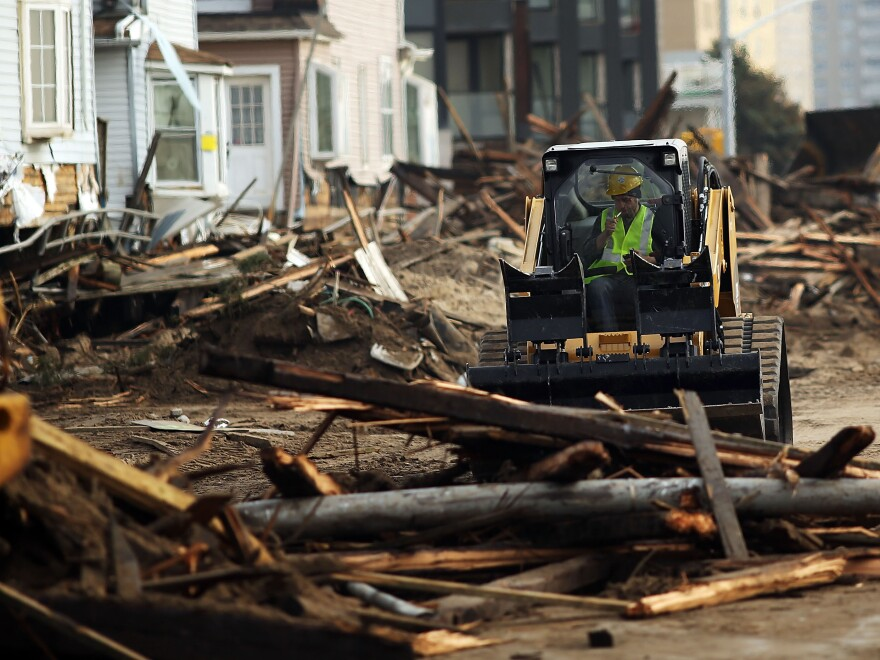 Two weeks after Superstorm Sandy, clean-up continues  in the heavily damaged Rockaway neighborhood of the Queens borough of New York City.