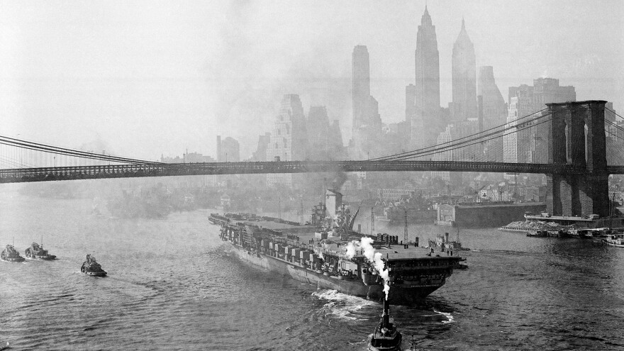 The USS Franklin D. Roosevelt sails down the East River after leaving the Brooklyn Navy Yard in 1945. Jennifer Egan's new book follows a woman who works the Brooklyn Navy Yard during World War II.