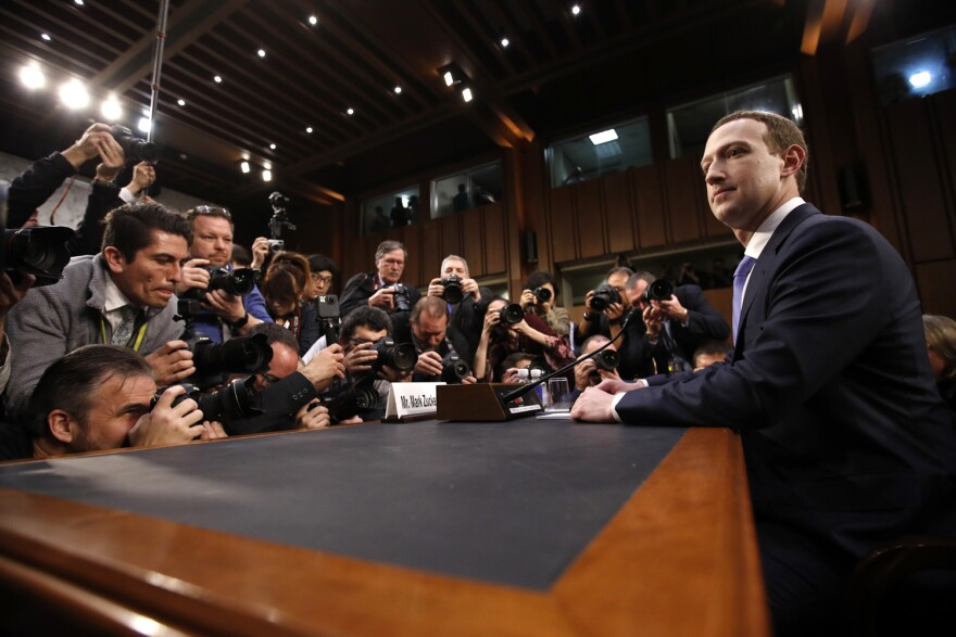 Facebook CEO Mark Zuckerberg takes his seat to testify before a joint hearing of the Commerce and Judiciary Committees on Capitol Hill in Washington, Tuesday, April 10, 2018, about the use of Facebook data to target American voters in the 2016 election. (AP Photo, Alex Brandon)