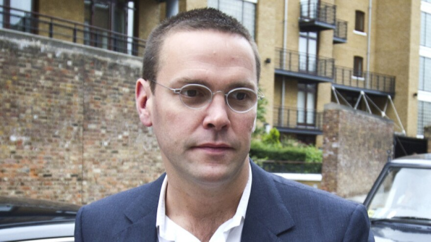 News International executive James Murdoch testified at a parliamentary hearing that he was unaware of a wider problem of cell phone hacking until a lawsuit in 2010.