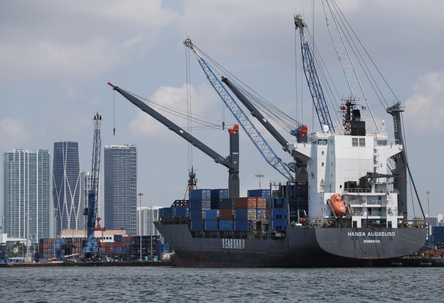 In this Wednesday, July 24, 2019 photo, the container ship Hansa Augsburg is shown docked at PortMiami in Miami. (AP Photo/Wilfredo Lee)