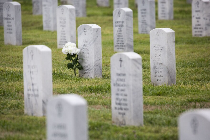 Flowers are placed near a headstone at the Central Texas State Veterans Cemetery in Killeen, Texas on Feb. 27, 2019.
