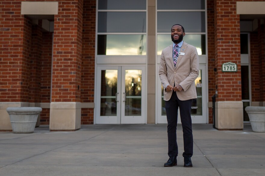 Marco Lee, a senior and student government president at Lindenwood University, poses in front of his dorm on the St. Charles campus on Dec. 7, 2020.
