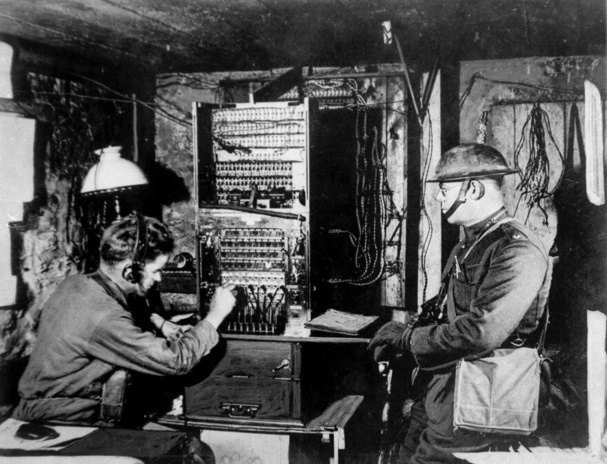 U.S. soldiers operate a radio switchboard just behind the front line during World War I. The U.S. government banned private radio in America during the war. However, the government poured millions into research, which helped advance the industry and led to the rise of commercial radio stations after the war, when the ban was lifted.