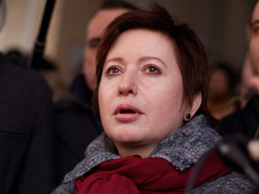 Kozlov's wife, Olga Romanova (shown here during his trial March 15), is a Russian journalist and opposition activist.