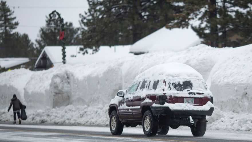 Snow piles continue to grow in Mammoth Lakes, Calif., on Monday, as a series of strong storms moves through the western U.S.