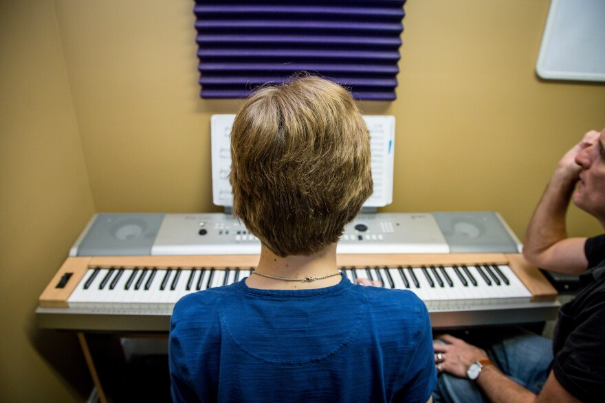 Reed takes a piano class with Christopher Maloney at Absolute Music Studios in Jupiter, Fla.