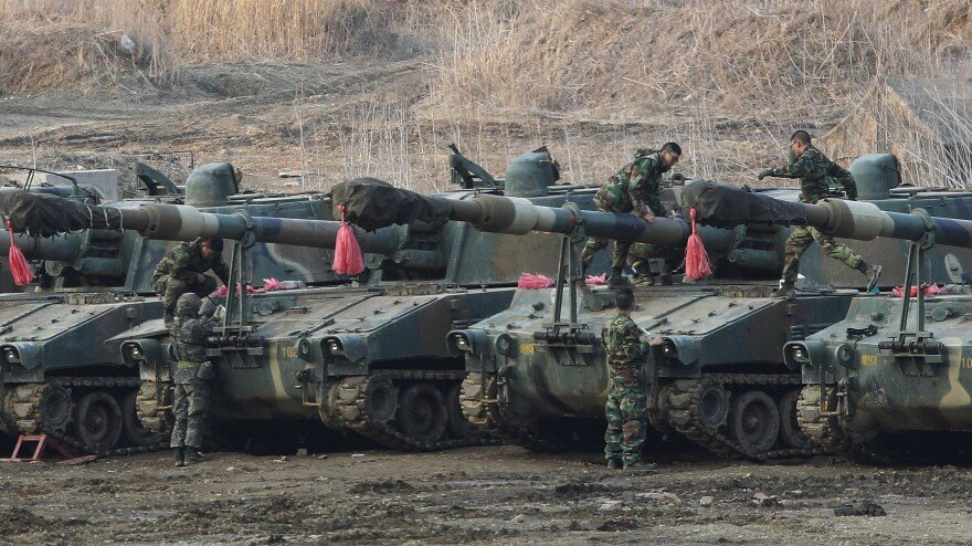 South Korean marines work on their K-55 self-propelled howitzers during an exercise against possible attacks by North Korea near the border village of Panmunjom in Paju, South Korea, Wednesday.