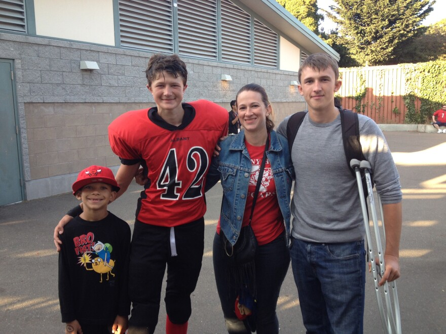 Garrison's older brother, Michael (far right), suffered a concussion playing football and also ended up quitting the sport. The brothers are shown here with cousin Sayyid Dawan (left) and aunt Lizzie Pennington.