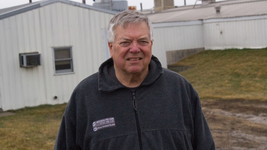 Farmer Howard Hill stands among his hog barns in Nevada, Iowa, where he also grows corn and soybeans and raises cattle.