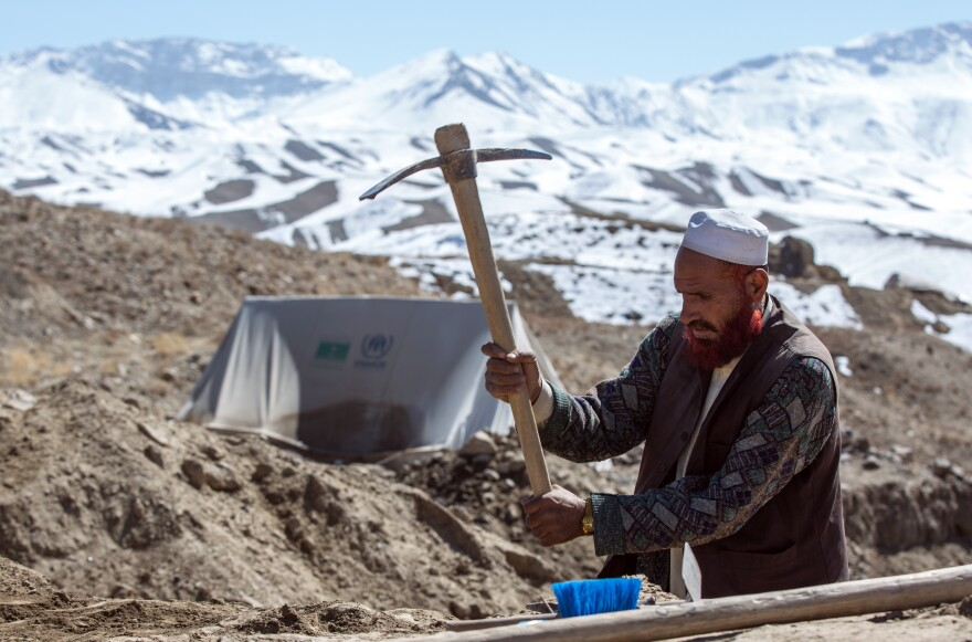 An Afghan worker helps excavate part of the mountaintop copper works above the ancient city at Mes Aynak in February. Afghanistan is believed to be sitting on massive mineral and metal deposits. But many obstacles have prevented large-scale mining from getting underway.