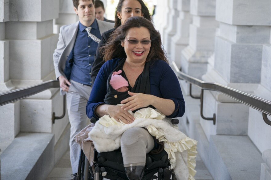 Sen. Tammy Duckworth, D-Ill., arrives at the Capitol for a vote with her new daughter, Maile, on Thursday.