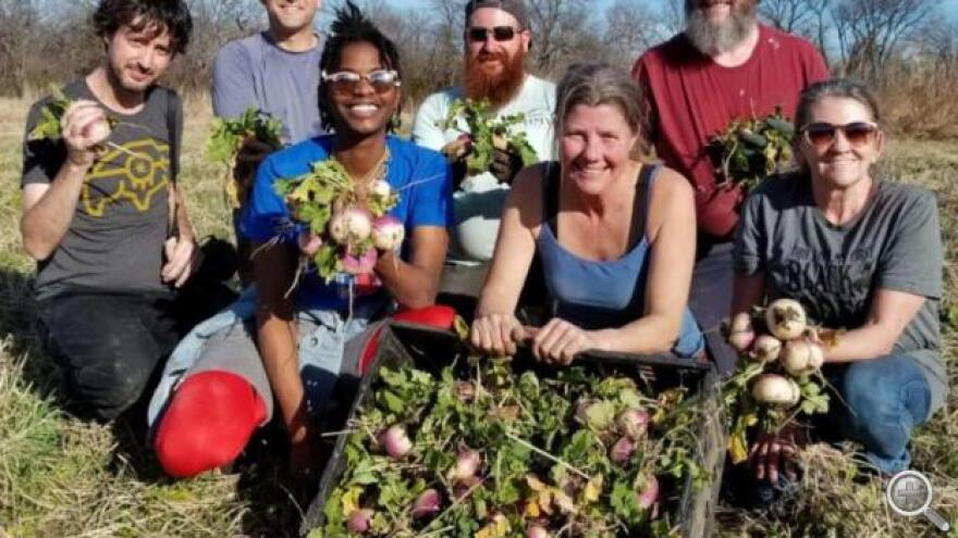 Katie Plohocky, executive director of the Healthy Community Store initiative, with gleaning volunteers.
