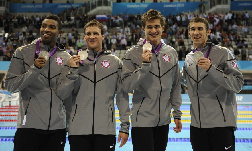 Americans Cullen Jones (from left), Ryan Lochte, Nathan Adrian and Michael Phelps pose with their silver medals for the men's 4x100-meter freestyle relay at the Aquatics Centre on Sunday.