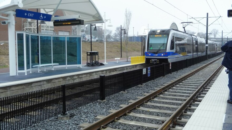 A Blue Line train approaches 9th Street Station uptown.