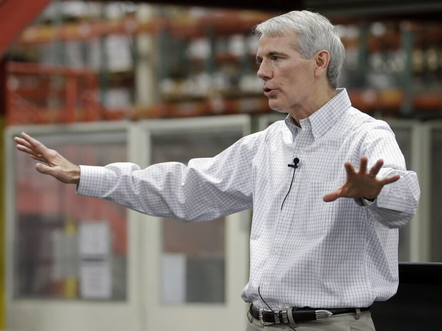 Sen. Rob Portman, R-Ohio, conducts a town hall meeting with employees after an October 2014 tour of Harris Products Group in Mason, Ohio.
