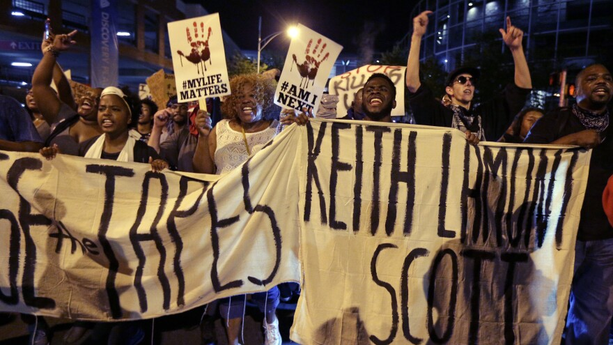 """People march in Charlotte, N.C., on Sept. 23 to protest the fatal police shooting of Keith Lamont Scott. The Mecklenburg County district attorney said Wednesday he was """"entirely convinced"""" that the officer who shot Scott """"was lawful in using deadly force."""""""
