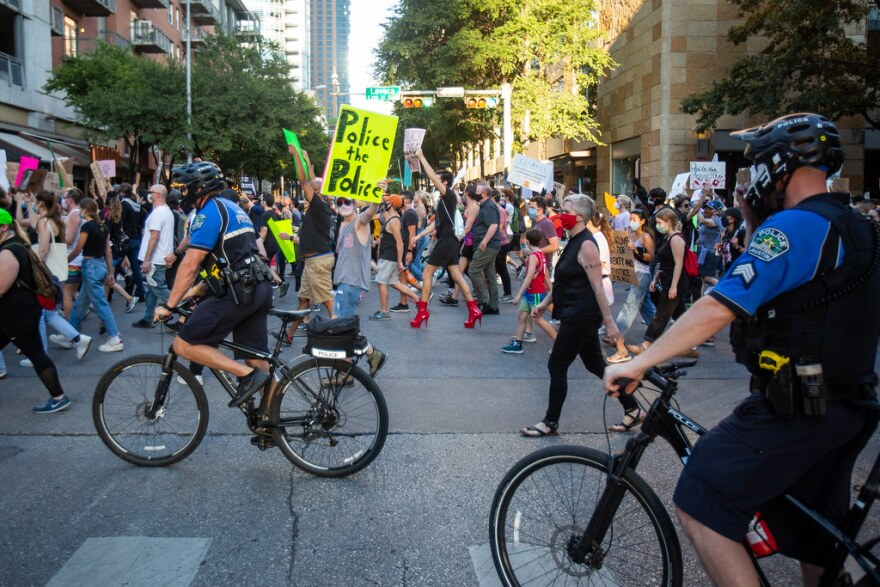 Protesters march in downtown Austin during a Black Lives Matter demonstration in June.