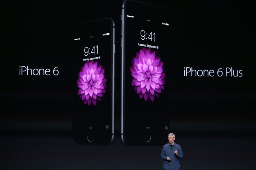 Apple CEO Tim Cook announces the iPhone 6 and iPhone 6 Plus at the Flint Center in Cupertino, Calif., Tuesday. The phones' diagonal screen sizes are 4.7 inches and 5.5 inches, respectively.