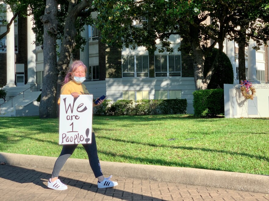 Karen Thomason marches against police violence at the Henderson County Courthouse Square in the East Texas city of Athens.