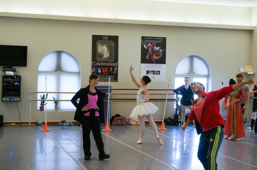 Artistic Director Karen Russo Burke (L) working with the dancers.