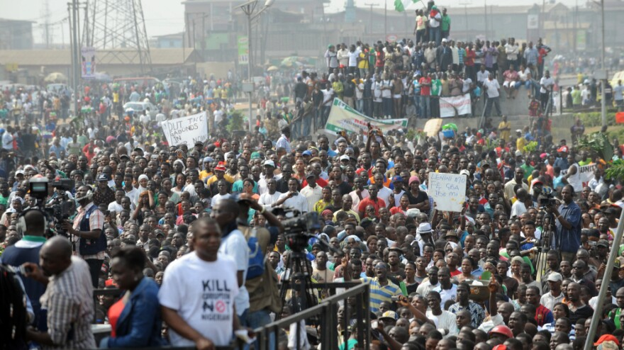 Protesters gather to protest against the end of gasoline subsidies in Lagos. Wednesday marked the third day of mass strikes by labor and civil society.