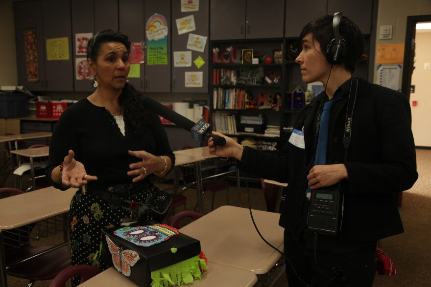 WYSO's Lewis Wallace interviewing Trotwood-Madison High School teacher Alicia Pagan.