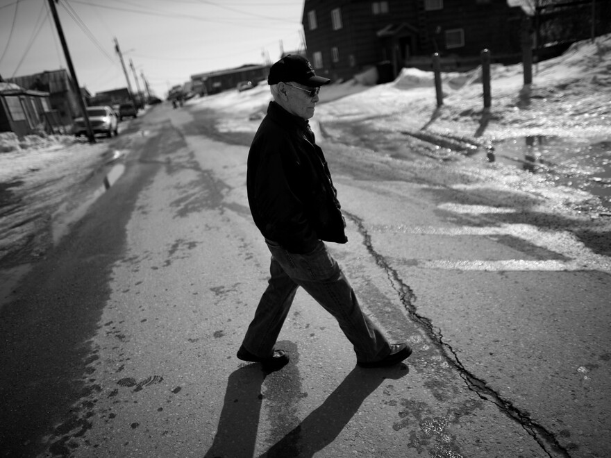 "Laban Iyatunguk, who served in the ATG, or ""Eskimo Scouts,"" walks away from the Veterans of Foreign Wars hall in Nome, where VA officials from Washington, D.C., were trying to register ATG vets. Iyatunguk says he has waited years to take advantage of his VA benefits but found the application process too daunting."