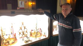 Ivan Medvesek stands in front of one of 21 dioramas in his Froggyland museum. On display is the work of Ferenc Mere, a Hungarian taxidermist who created these exhibits more than a century ago. Medvesek's parents purchased the displays after they were left behind in an attic in what is now Serbia in 1970. After losing revenue in the pandemic, Medvesek says he's selling Froggyland to U.S. investors.