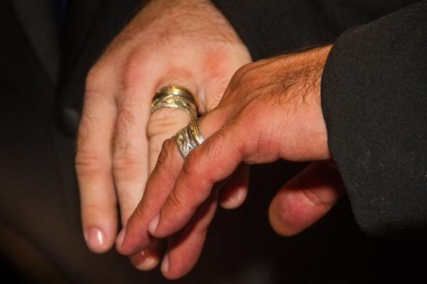Aaron Huntsman and William Lee Jones, the first same sex couple to be wed in Key West, show off their wedding bands.