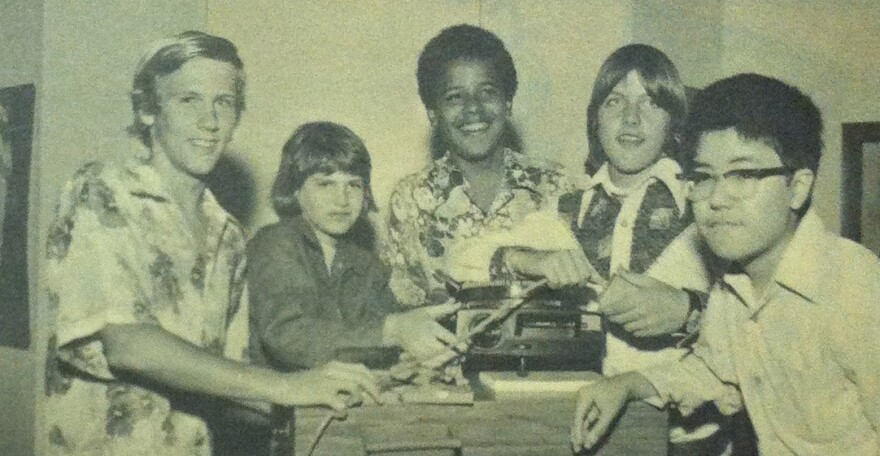"""Barack Obama in a 1975 photo from the Punahou School yearbook. He and his eighth-grade homeroom classmates pose with a slide projector as part of the yearbook's theme of """"Nostalgia."""""""