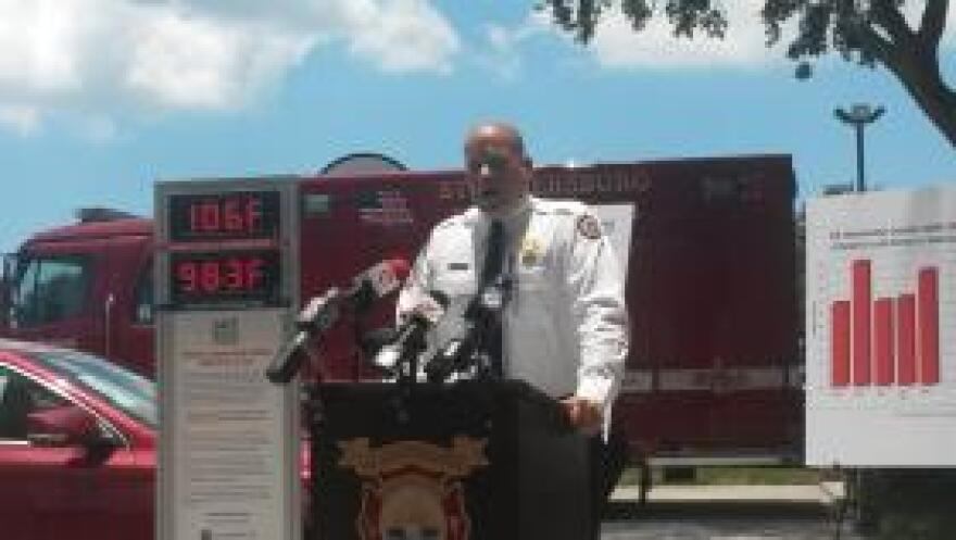 Lt. Steve Lawrence, deputy fire marshal with St. Petersburg Fire & Rescue, with a thermometer that shows how quickly cars can heat up.
