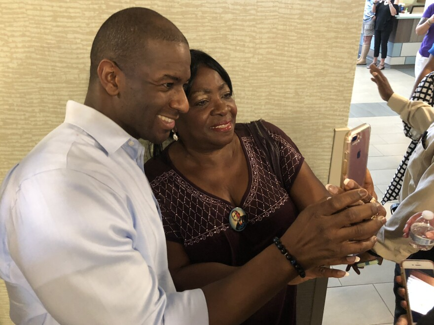 Andrew Gillum, the Democratic nominee for governor of Florida, takes a selfie with Dorothy Himmelstein after a campaign event in Flagler County.