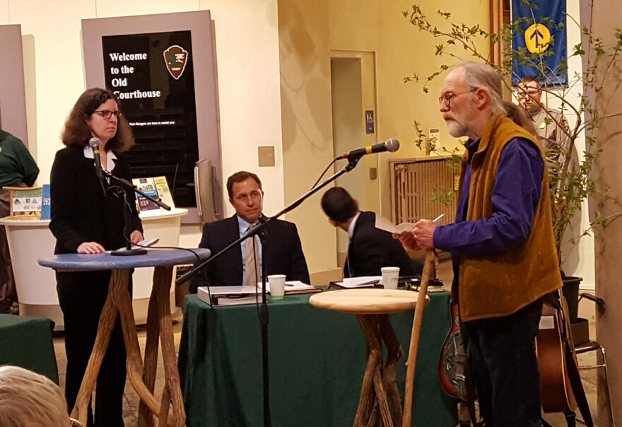 """""""Plaintiff"""" Dale Dufer, shown at right, reads a statement at the mock trial against bush honeysuckle on April 4, 2018. Dufer organized the event to help draw attention to the damaging effects the invader has on native plants."""