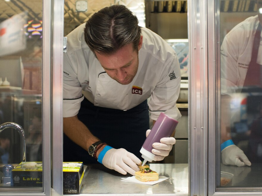 At the IBM food truck, chef James Briscione serves up Baltic apple pie — a dish that includes pork loin, apples and garlic chips.
