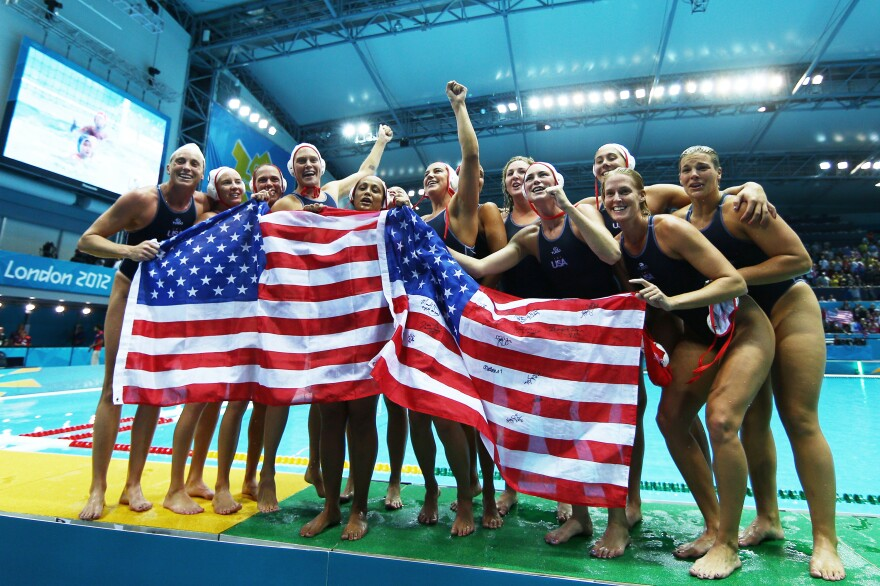 The U.S. women's water polo team celebrates after winning the gold medal match against Spain at the London Olympic Games in 2012.