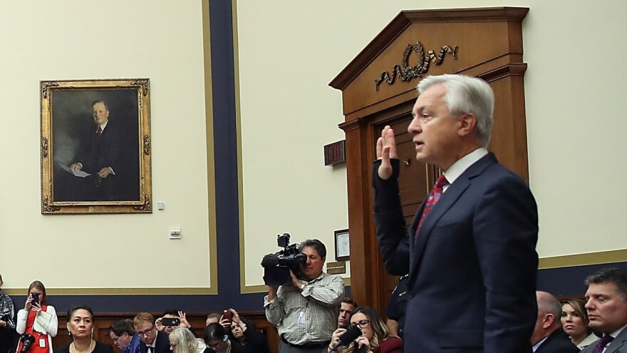 John Stumpf, the former chairman and CEO of Wells Fargo, will repay $28 million to the bank over an improper sales practices scandal. He's seen here visiting the House Financial Services Committee last September.