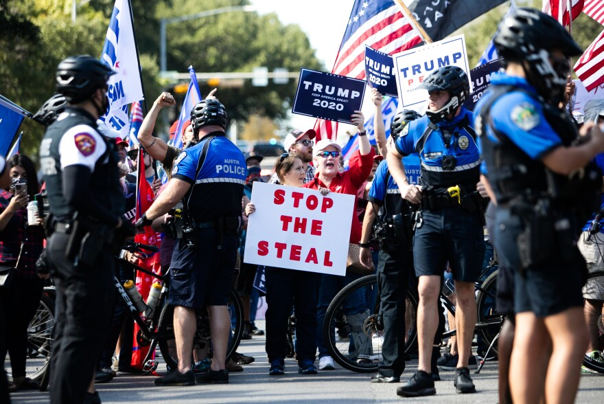 <strong>AUSTIN, TEXAS:</strong> Simultaneous demonstrations in support of President-elect Joe Biden and current President Trump face off in front of the Texas State Capitol in downtown Austin following the announcement of the final presidential election results.