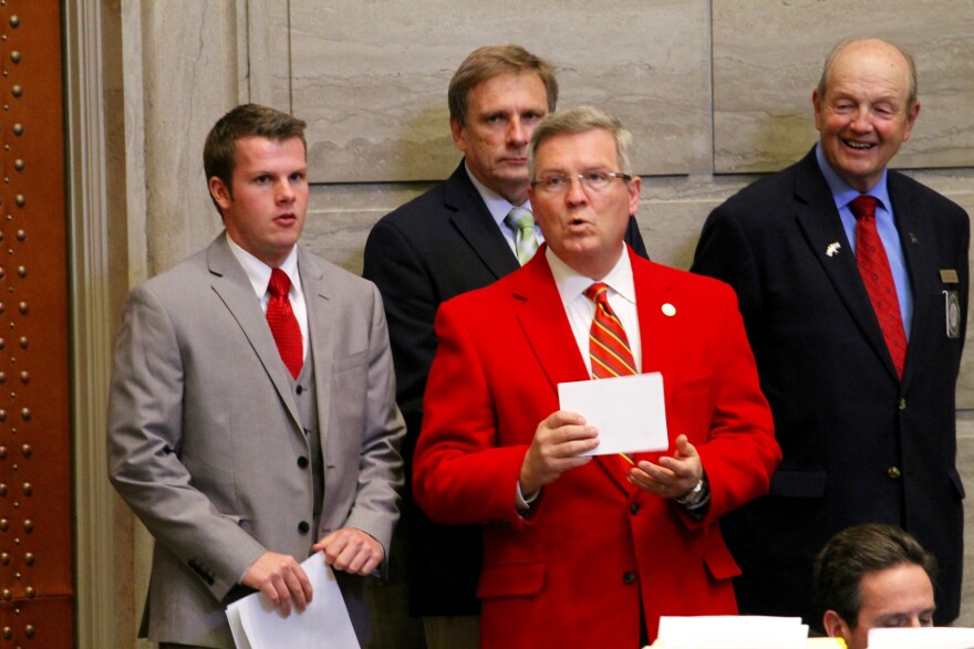 Sen. David Pearce, center, stands at the side of the Missouri Senate chamber. The Warrensburg Republican often wears his red sportcoat on the last day of session.
