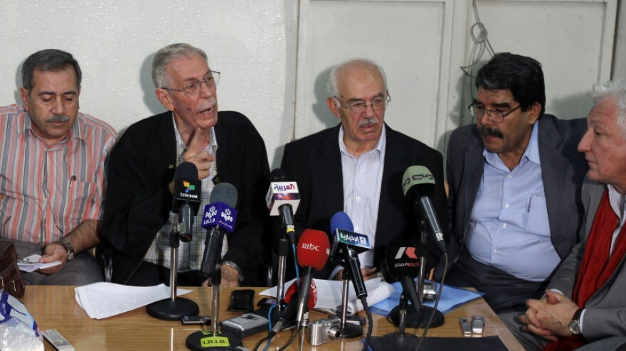 More than 300 Syrian dissidents met near Damascus on Sunday, and afterward they held a news conference and called for more protests to oust President Bashar Assad's government. From left: Rajaa Nasser, Hussein Awdat, Hassan Abdul Azim, Saleh Mohammed and Samir Aita.
