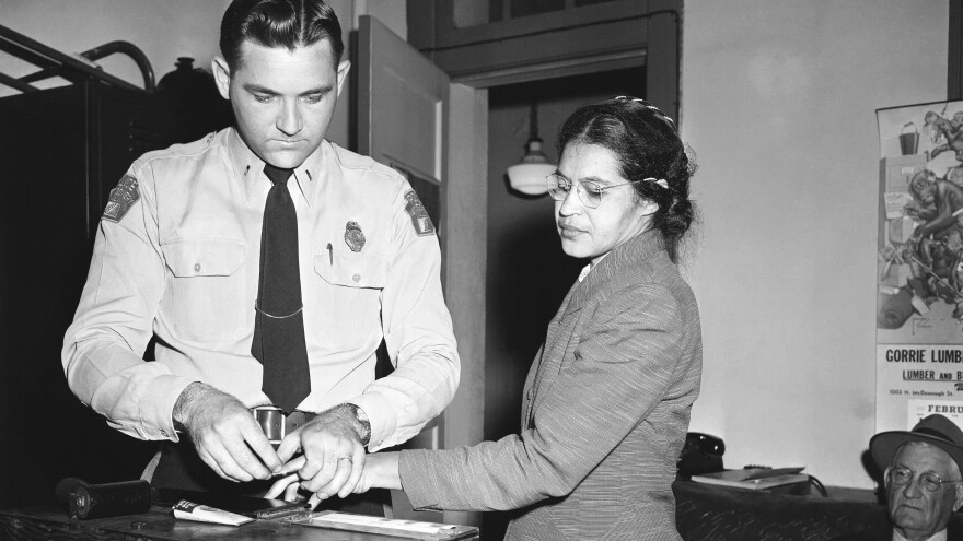 Rosa Parks, whose refusal to give up her seat touched off the Montgomery bus boycott and the beginning of the civil rights movement, is fingerprinted by police Lt. D.H. Lackey in Montgomery, Ala., Feb. 22, 1956, when she was among several others charged with violating segregation laws.