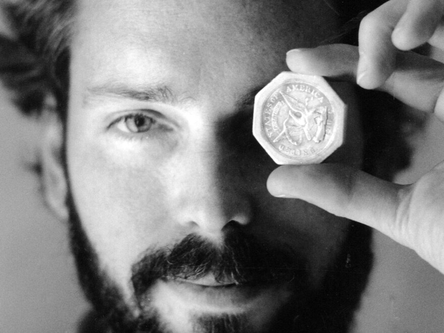 A November 1989 photo of Tommy Thompson holding a $50 pioneer gold piece retrieved from the wreck of the SS Central America. Thompson, who had been on the lam for two years, was arrested on Tuesday.