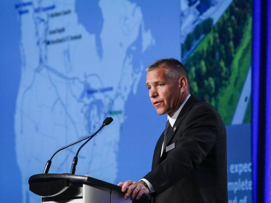 Russ Girling, president and CEO of TransCanada Corporation, addresses the company's annual meeting in 2015 in Calgary, Alberta.