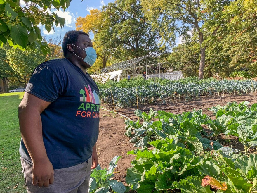 "Carl Childs works after school with Appetite for Change, helping provide produce to families who can't easily access it. ""It's really important and I love it, giving back to the community,"" he says."
