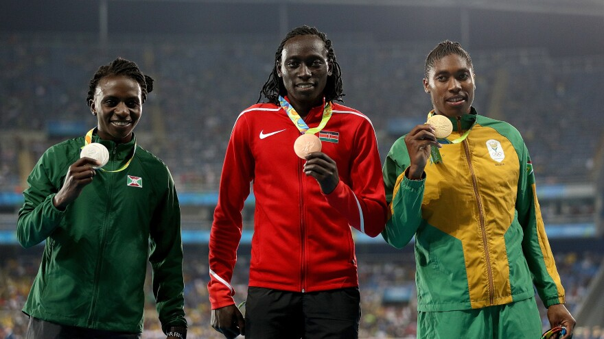 Silver medalist Francine Niyonsaba (L) of Burundi, gold medalist Caster Semenya (R) of South Africa and bronze medalist Margaret Nyairera Wambui (C) of Kenya stand on the podium during the medal ceremony for the Women's 800 meter at the Rio 2016 Olympic Games.